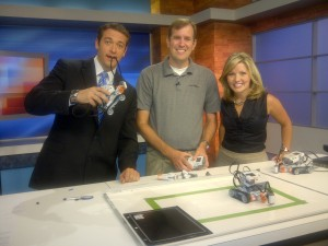 People with robots - Axia Public Relations Client Pragmatic Works on WJXT