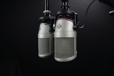 A pair of microphones for podcasting.