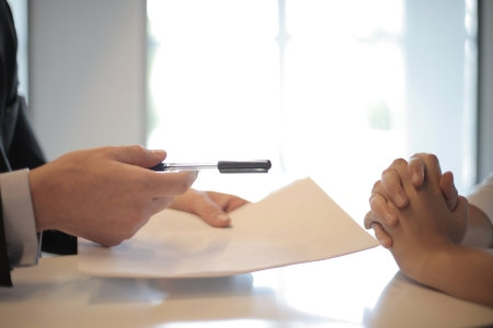 An insurance agent talking with a client.