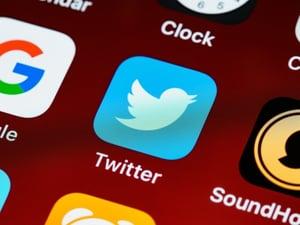 Twitter's logo on a screen.
