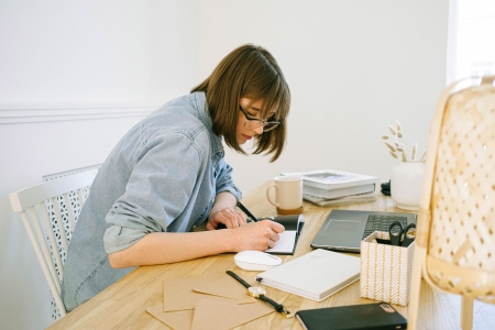 A woman working from home.