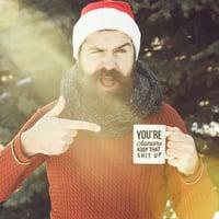 Man holding a coffee mug.