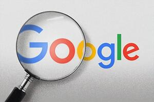 Google logo with a magnification glass over it.