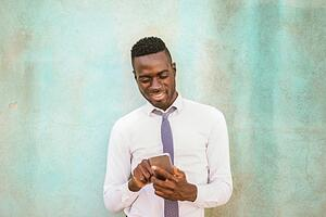 A happy man viewing content on Instagram via his phone.