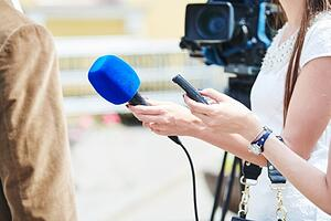 A news interview, showing the value of earned media in PR.