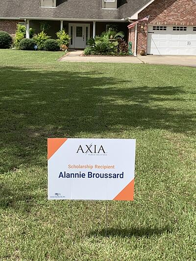 The Axia scholarship yard sign in Alannie's yard.