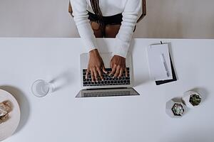 A person typing on a computer.