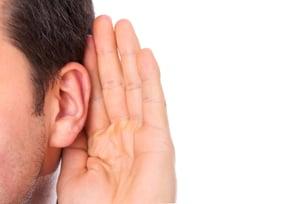 A man listening.