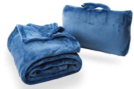A blue folding travel blanket.