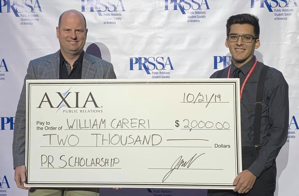 William Careri being presented a PR scholarship from Jason Mudd.